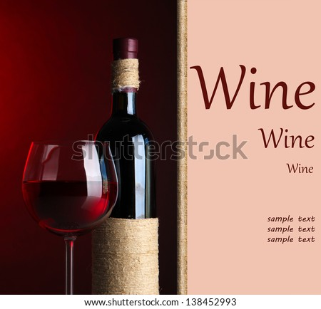 Bottle and glass with wine on dark red background - stock photo