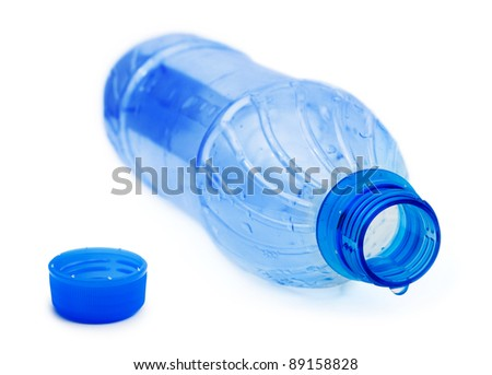 Bottle and water drop isolated on white background - stock photo