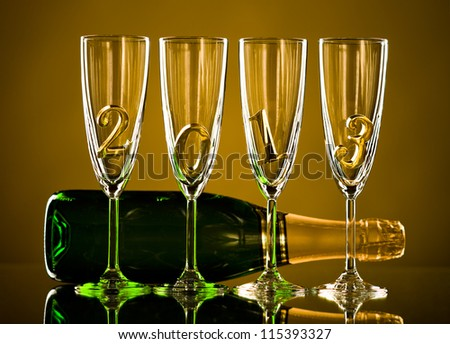 bottle  champagne with four glass goblet and  numeral 2013,  beautiful celebrations  New Year concept photo - stock photo