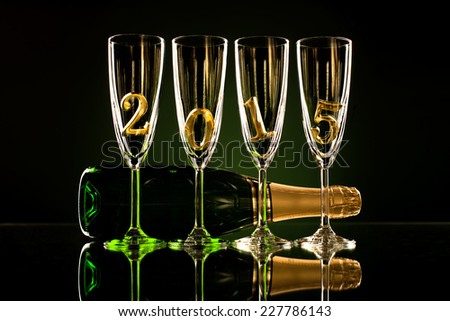 bottle  champagne with four glass goblet and  numeral 2015,  beautiful celebrations  New Year concept photo - stock photo