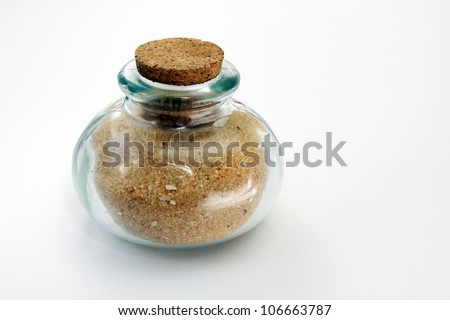 Bottle filled with sand - stock photo