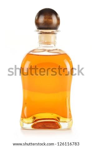 Bottle of alcoholic product isolated on white - stock photo
