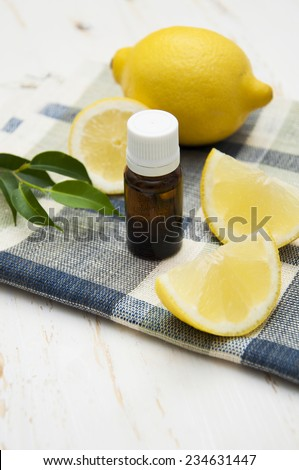 Bottle of aromatherapy lemon - natural essential oil  - stock photo