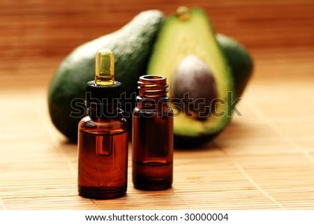 bottle of avocado essential oil - beauty treatment - stock photo