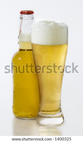 Bottle of beer with full pint glass - stock photo