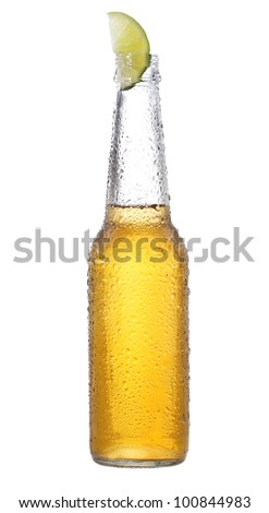 bottle of beer with lime on white background - stock photo