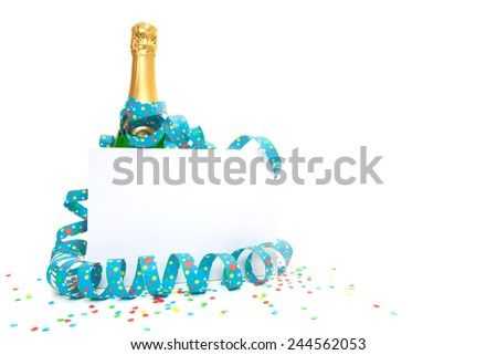 Bottle of champagne behind blank sign. - stock photo