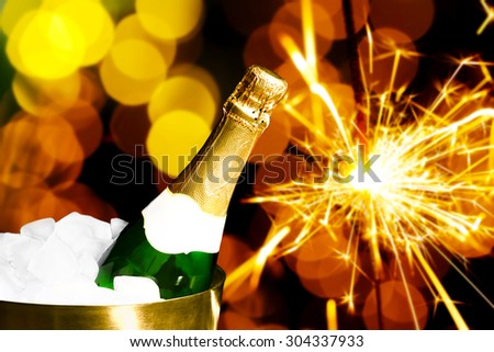 Bottle of champagne in bucket with ice, on bright background - stock photo