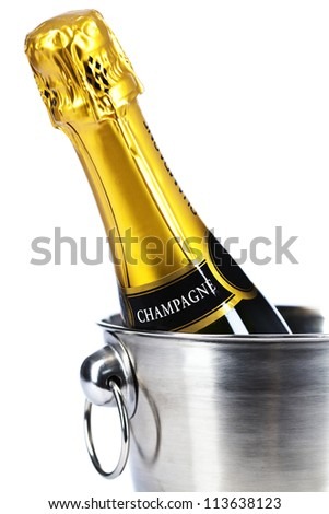 Bottle of champagne in cooler over white - stock photo