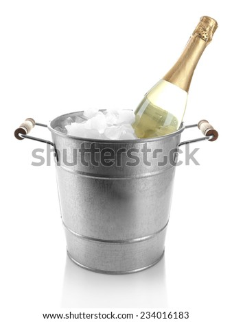Bottle of champagne in metal ice bucket isolated on white - stock photo