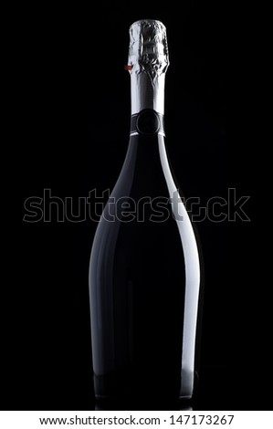 Bottle of champagne on black  - stock photo