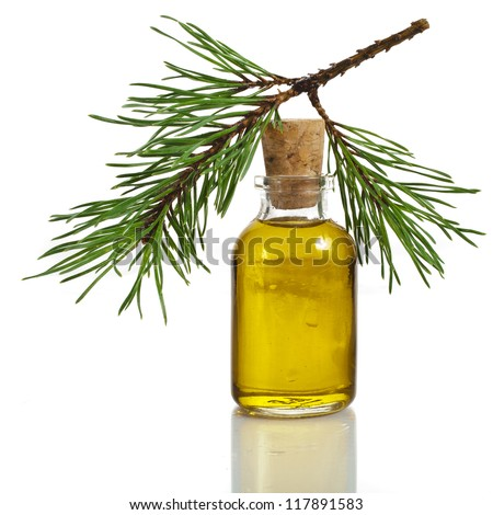 Bottle of fir tree essential oil on a white background close up - stock photo