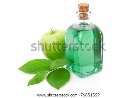 bottle  of  liqueur / alcohol with green apple - stock photo