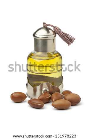 Bottle of Moroccan cosmetic Argan oil and nuts  - stock photo