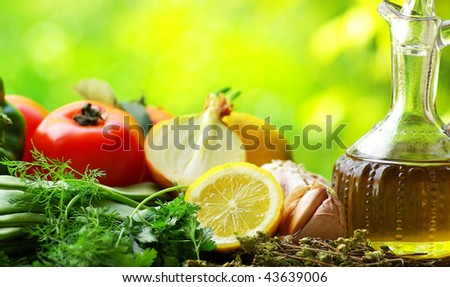Bottle of Olive oil and condiments. - stock photo