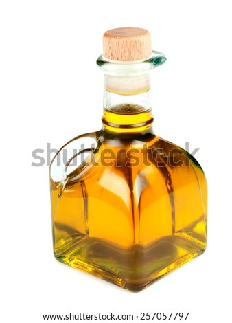 Bottle of olive oil isolated on white background, close up - stock photo