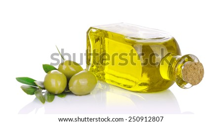 Bottle of olive oil with olives on white background. - stock photo