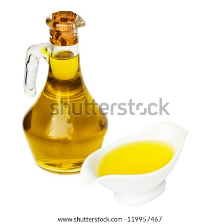 bottle of olive  oil with saucer isolated on white background - stock photo