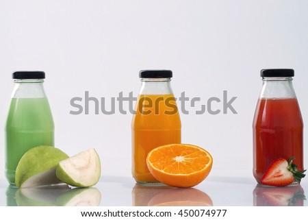 bottle of orange juice Guava juice and strawberry juice with white Background - stock photo