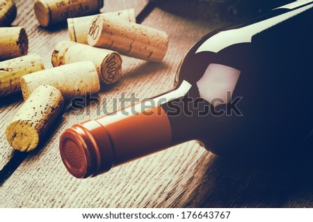 Bottle of red wine and corks  - stock photo
