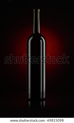 Bottle of red wine on black background - stock photo