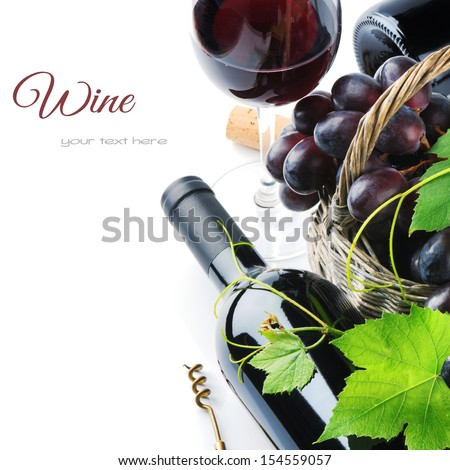 Bottle of red wine with freshly harvested grape in basket  - stock photo