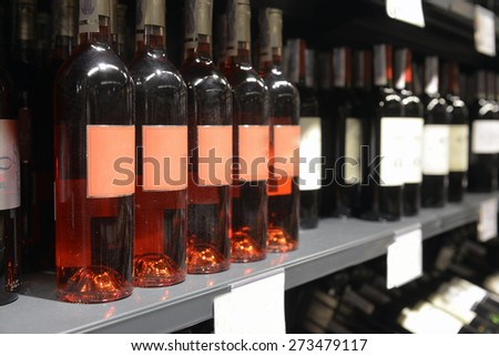 bottle of rose wines in the store - stock photo