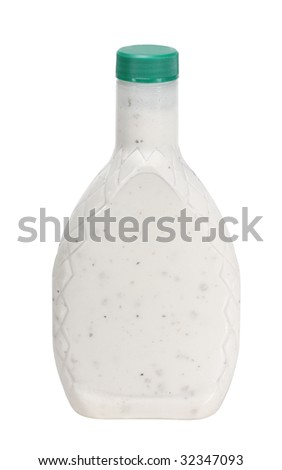 Bottle of salad dressing isolated on white - stock photo