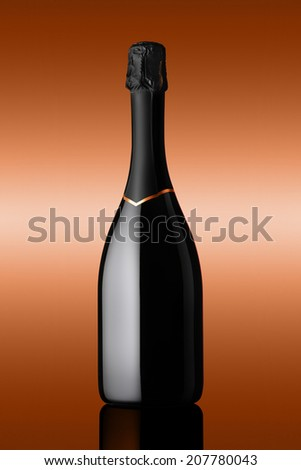 bottle of sparkling wine on background bronzed - stock photo