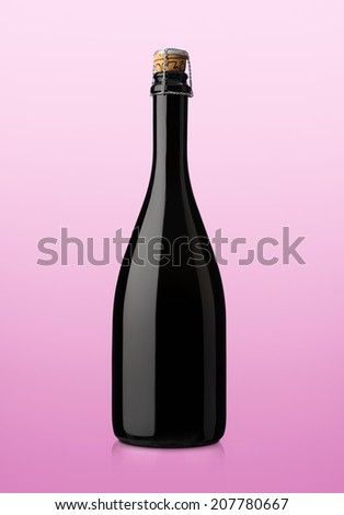 bottle of sparkling wine on pink background  - stock photo
