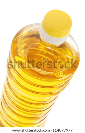 Bottle of sunflower oil closeup isolated on white background - stock photo
