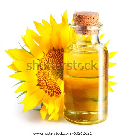 Bottle of sunflower oil with flower on a white background. - stock photo