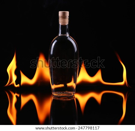 Bottle of tequila on fire - stock photo