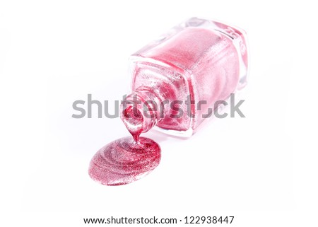 Bottle of the pink nail polish isolated - stock photo