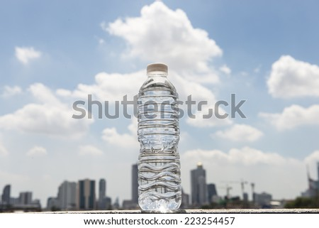 bottle of water on sky background  - stock photo