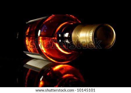 Bottle of whisky with black crisp background - stock photo