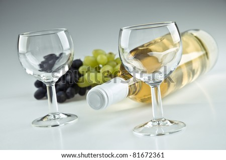 Bottle of white wine and two glasses - stock photo