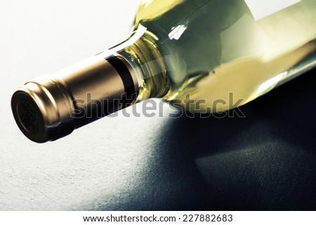 Bottle of white wine on dark background - stock photo