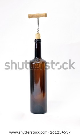 bottle of wine and a corkscrew with cork - stock photo