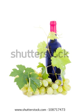 Bottle of wine and grapes and leaves. - stock photo