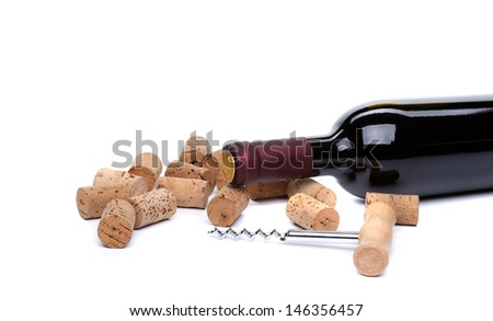 bottle of wine, corks and corkscrew. - stock photo