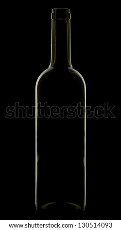 Bottle of wine in low key lighting. Isolated on black. - stock photo