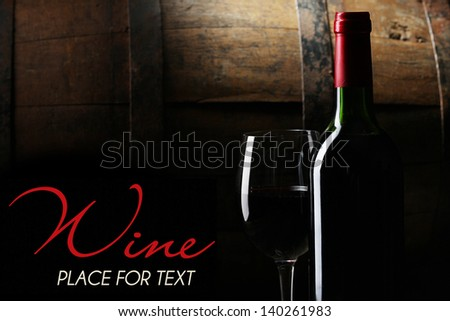 Bottle of wine on black background - stock photo