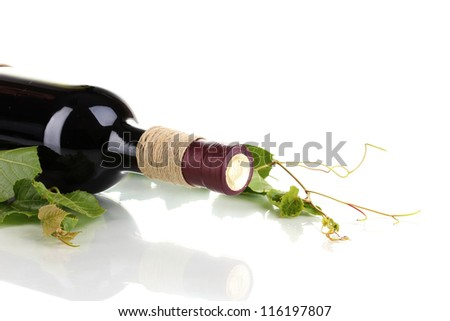bottle of wine with grape leaves isolated on white - stock photo