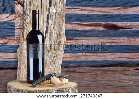 bottle of wine with Greece flag in the background - stock photo