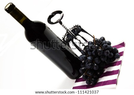 bottle red wine with grapes on a white background - stock photo