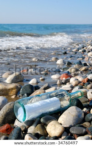 Bottle with a letter inside - stock photo
