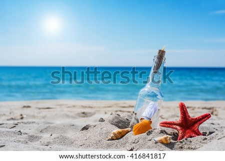 bottle with message on a tropical beach - stock photo