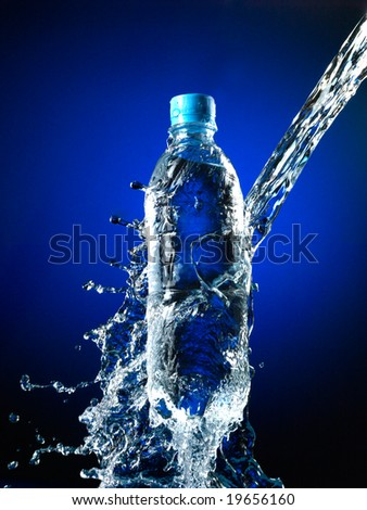 Bottle with pure water and splash around it. - stock photo