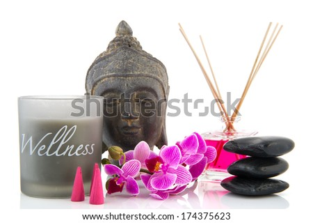 Bottle with scented sticks and silk roses - stock photo